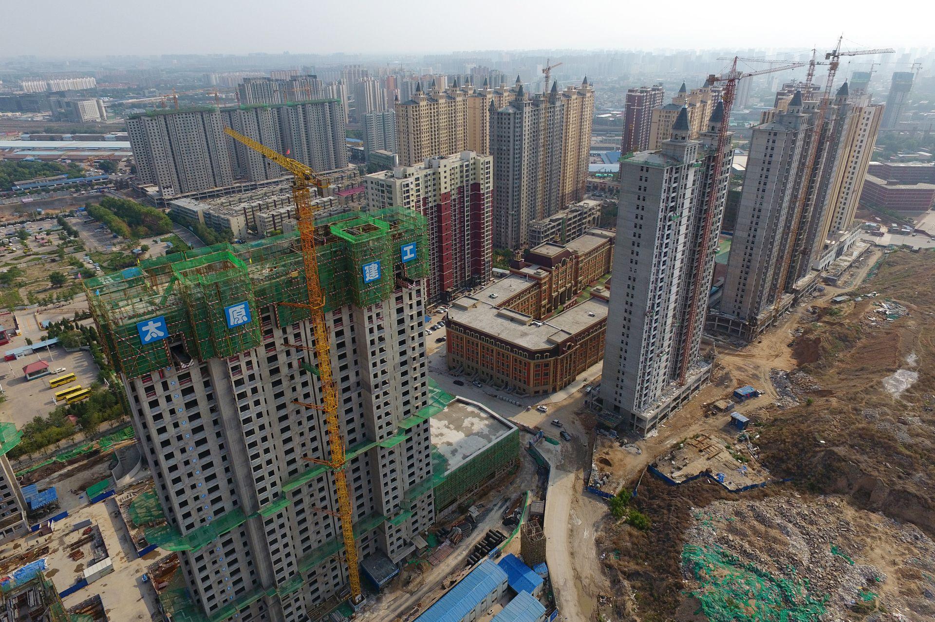 毛振華:要高度重視並妥善處置房地產領域債務風險